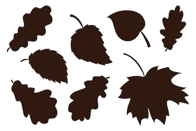 手描きの葉の影のコレクション。森の葉シルエット要素セット。プリント、ステッカー、招待状、グリーティングカードのデザインと装飾のための秋の装飾要素。プレミアムベクトル