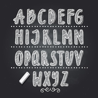 Hand drawn letters writing on black school chalkboard. vector alphabet