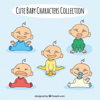 異なるポーズで手描き美しい赤ちゃん