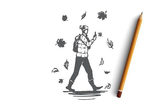 葉の秋のコンセプトスケッチの下でスマートフォンで歩く手描きの男