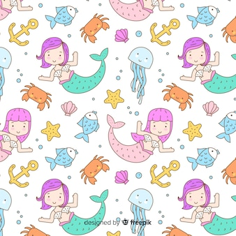 Hand drawn mermaids swimming pattern