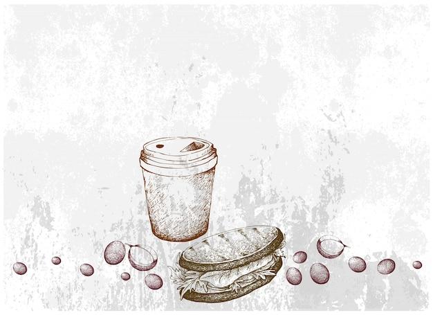 使い捨てコーヒーカップの手描きのグリルサンドイッチ