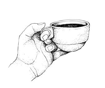 カップのホットコーヒーを持っている手の手描き
