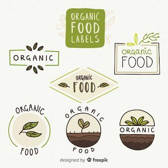 Ручной обращается коллекция этикеток органических продуктов питания