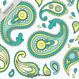 Ручной обращается декоративный зеленый и желтый фон петрушки