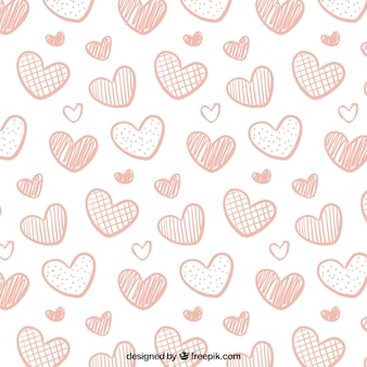 Hand-drawn pattern of decorative pink hearts for valentines day