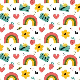 虹、花、ギフトボックスと手描きのパターン