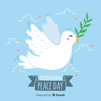 Hand-drawn peace day dove blue background