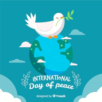 Hand drawn peace day with dove on earth