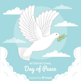 Hand drawn peace day with dove and olive leaf