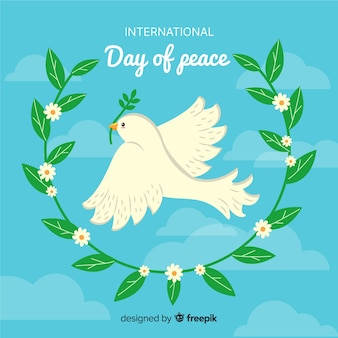 Hand drawn peace day with dove and olive leaves