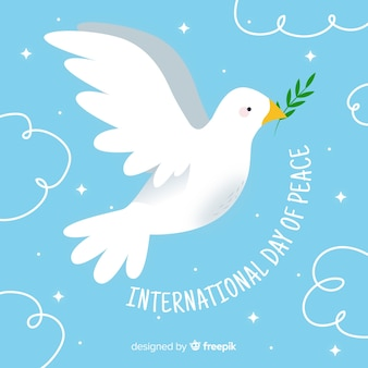 Hand drawn peace day with dove