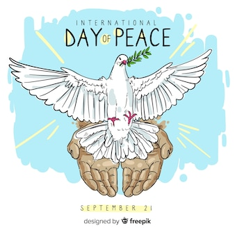 Hand drawn peace day with a dove