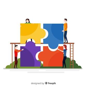 パズルの背景を作る手描きの人々