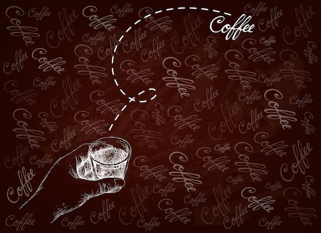 コーヒーのショットを保持している手描き下ろし人