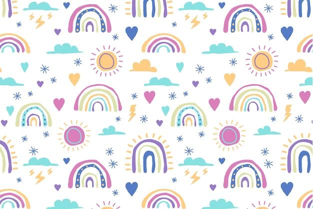 Hand drawn rainbow pattern design Free Vector