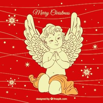Fondo rosso disegnato a mano con un angelo di natale