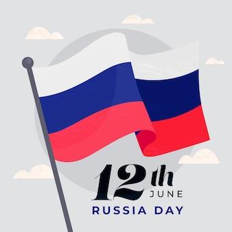 ポールに描かれたロシアの日の旗を手します。