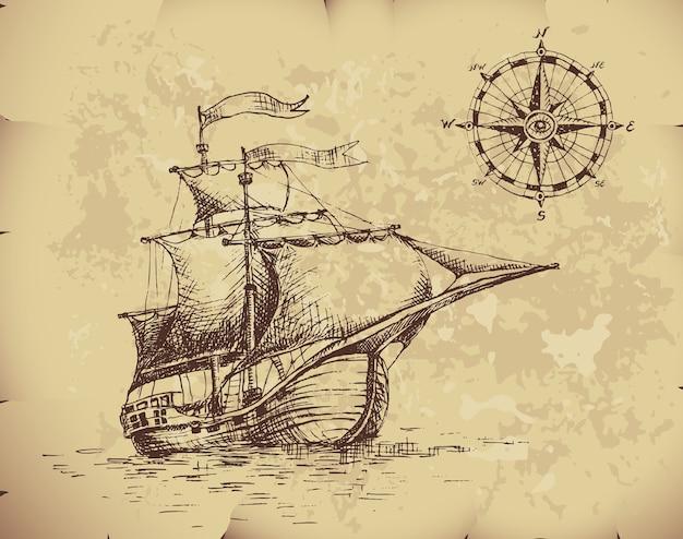 Ручной обращается парусник и компас на старой бумаге.