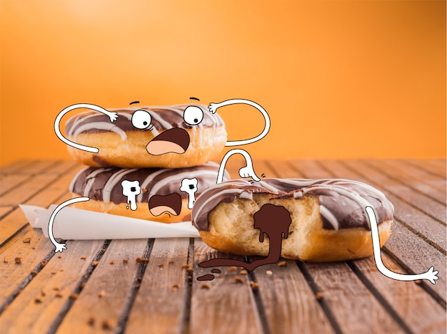 Hand drawn scared chocolate donuts