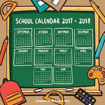 Hand drawn school calendar background with blackboard