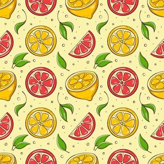 レモン、グレープフルーツ、葉で手描きのシームレスな背景。