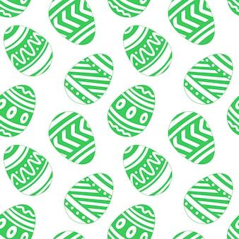 手描きのシームレスなパターンの白い背景の上の緑のイースターエッグデザイン