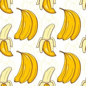 Ручной обращается бесшовные модели с бананами на белом фоне.