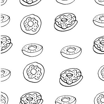 ドーナツと手描きのシームレスなパターン
