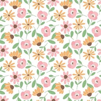 平らな花と手描きのシームレスなパターン