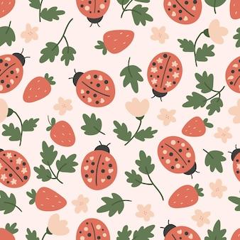 Hand drawn seamless pattern with ladybug and strawberry