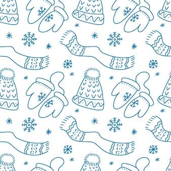 落書きスタイルのメリークリスマス帽子スカーフ雪片ミトンと手描きのシームレスなパターン