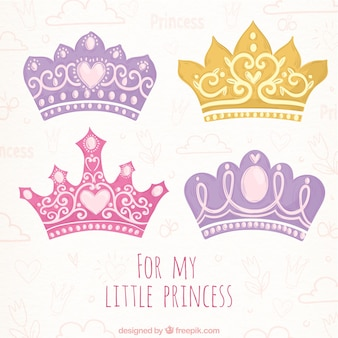 Hand-drawn selection of four colored princess crowns