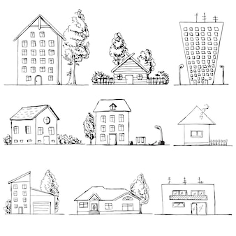 손으로 그린 다른 집의 집합입니다. 스케치 스타일의 그림입니다.
