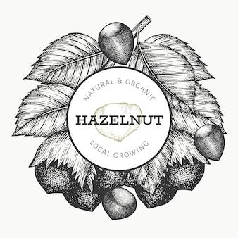 손으로 그린 스케치 헤이즐넛 디자인 서식 파일입니다. 유기농 식품 일러스트입니다. 빈티지 너트 그림입니다. 새겨진 스타일 식물 배경.