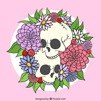 Teschi disegnati a mano con fiori decorativi
