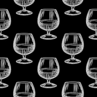 Hand drawn snifter glass seamless pattern. glass of brandy or cognac on black background. Premium Vector
