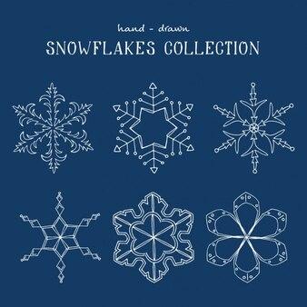 Collezione disegnata a mano i fiocchi di neve