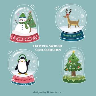 Ручной обращается snowglobes с рождественских символов