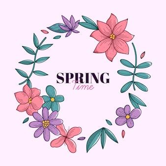 手描きの葉と春の花のフレーム