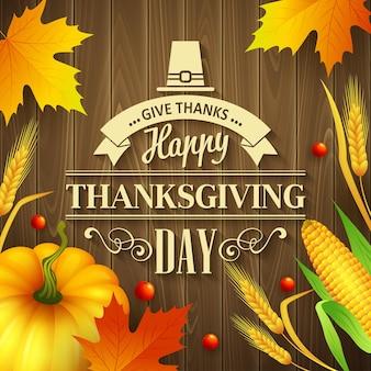Cartolina d'auguri di ringraziamento disegnata a mano con foglie, zucca e spica su fondo di legno. illustrazione vettoriale eps 10