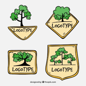 Набор логотипов рисованной древесины