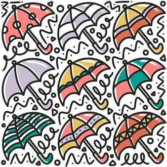 Hand drawn umbrella doodle set with icons and design elements