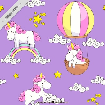Hand drawn unicorn with rainbow and balloon  pattern