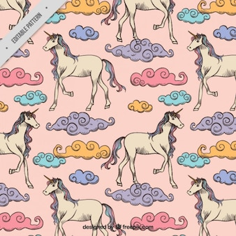 Hand drawn unicorns with colored clouds pattern