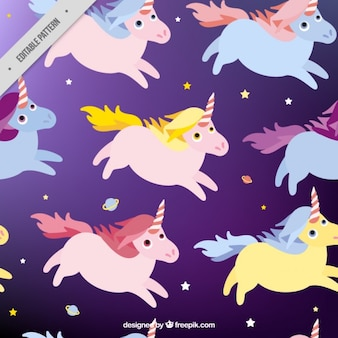 Hand drawn unicorns with planets and stars pattern