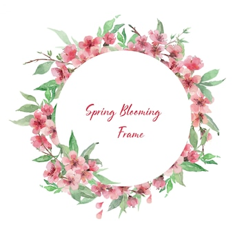 Hand drawn watercolor circle frame template with cherry blooming branches