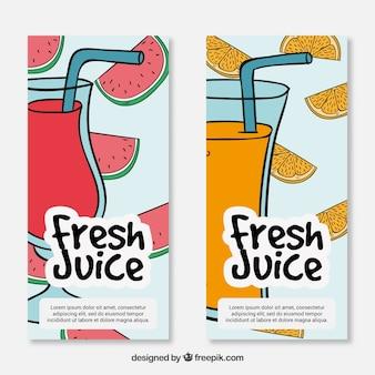 手描きのスイカとオレンジの果物ジュースのバナー