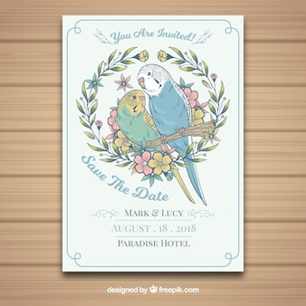 Hand drawn wedding card with parrots