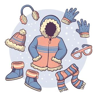 Abbigliamento invernale ed elementi essenziali disegnati a mano